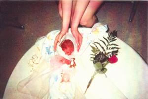 Tess-cradling-baby
