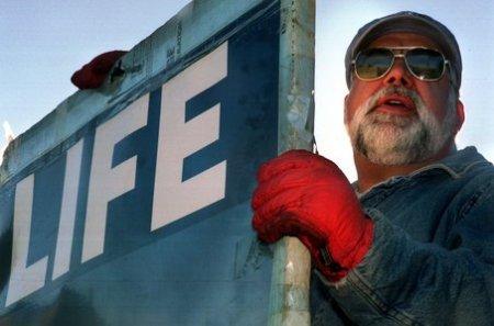 James Pouillon Holding Pro-Life Sign