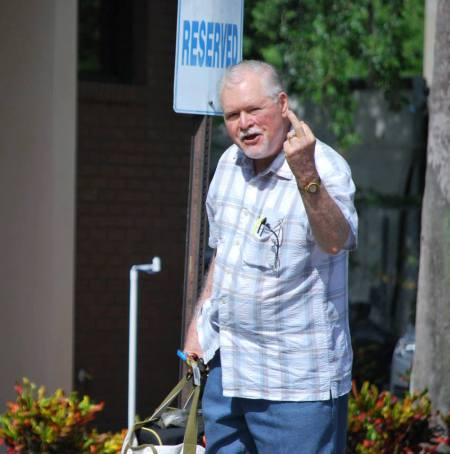 "Abortionist Randall Whitney shoots the finger at pro-life activist because she refused to call him ""doctor."""