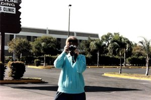 Joyce Tarnow outside her abortion clinic attempting to take pictures of protesters.