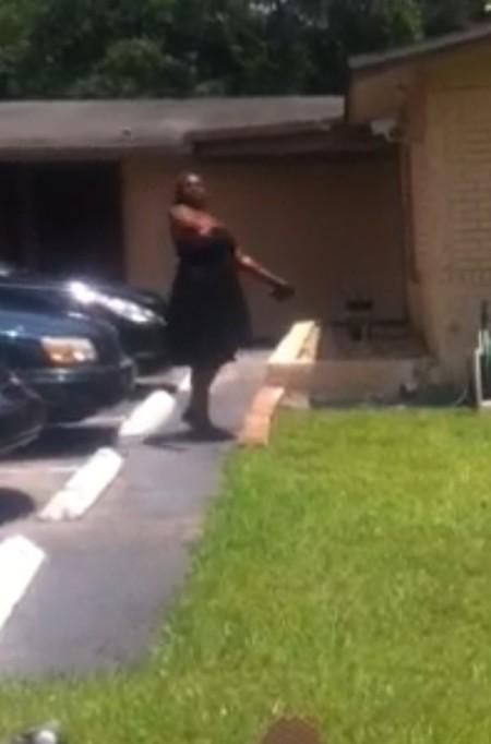 Pro-choice woman hurls rock at pro-lifers