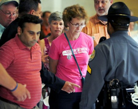 Janet Colm, CEO of Planned Parenthood of Central North Carolina, is arrested for an act of civil disobedience at the North Carolina Legislative Building in downtown Raleigh