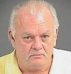 Gary Boyle arrested after pointing a gun at demonstrators