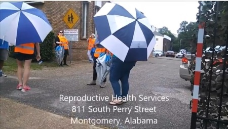 Image: Abortion escorts outside Reproductive Services June 2017